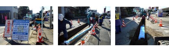 公道下の給水本管の敷設工事を施工する作業班